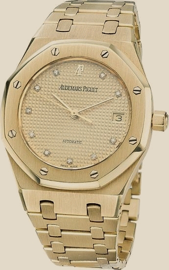 Audemars Piguet - royal oak yellow gold